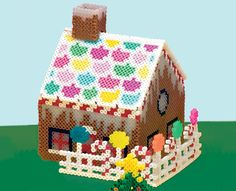 This is a fun project for a family to create together with Perler Beads! Complete with candy canes, lollipops, and a gumdrop roof, this sweet treat will make a colorful holiday display.