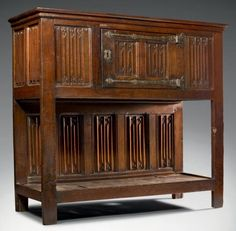 Late 15th century dresser featuring linenfold panels.