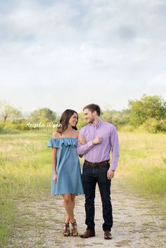 DFW Fort Worth Aledo Coppell photographer Angela Wynn photography: engagement session, cute, field, quilt, back light, gorgeous, love, wild flowers, summer session, styled, fun, nature, portrait ideas, beautiful, photography, creative, unique, couples ideas, outfits, engagements, young love, classy