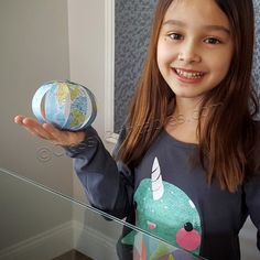 Earth Day crafts for kids. Simple straight cuts and working with brads (no glue) make this an easy accomplishment for little hands. Make a paper globes by assembling the strips numbered 1- 8!  Step-by-step instructions with pictures are included. Learn all about Earth Day with a FREE Earth Day history fact sheet.