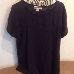 Micheal Kors Top Micheal Kors Top that's black the top half portion of the shirt has a dull shine look to it the shirt is 100%polyester Michael Kors Tops