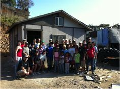 Recipient of the new house and house-building volunteers at the end of the day. #Charity #Nonprofit #Corazon