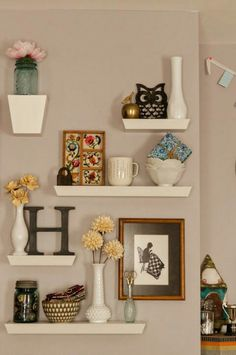 Blank Wall By Back Door. Playful Display Have Fun With Shapes And Angles  When You Group Shelves Of Different Sizes Into A Pretty, Wall Collage.