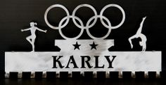 The # 1 Creator of Metal Home Wall Décor, Custom Wall Plaques, Personalized Medal Holders and Personalized Sports Trophy Shelves Gymnastics Medal Holder, Trophy Shelf, Sports Trophies, Ribbon Holders, Award Display, Medal Holders, Home Wall Decor, Wall Plaques, Color Show