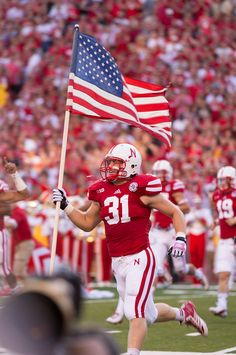 Zimmerer carries the American flag onto the field as the University of Nebraska-Lincoln Cornhuskers prepare to take on the Wyoming Cowboys in Memorial Stadium on Saturday, August in Lincoln, Neb. By: KENT SIEVERS/THE WORLD-HERALD Wyoming Football, Nebraska Cornhuskers Football, Nebraska Football, Wyoming Cowboys, Football Fans, College Football, Football Players, August 31, Vintage Football