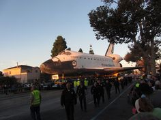 Shuttle Endeavour in the Dawn Light  The rising sun bathes space shuttle Endeavour in a golden glow as it rolls down Martin Luther King Jr. Boulevard on Oct. 14, 2012.  CREDIT: Mike Wall/SPACE.com