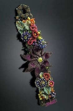~~Settembre Fiori Cuff: Julie Powell: Beaded Bracelet~~ Julie deserves to be able to have showings, much like Laura McCabe, she exhibits incredible talent, as she lovingly adds beads to her masterpieces! Bead Embroidered Bracelet, Bead Embroidery Jewelry, Beaded Bracelet Patterns, Jewelry Patterns, Beaded Embroidery, Beading Patterns, Beaded Bracelets, Embroidery Bracelets, Beaded Jewelry
