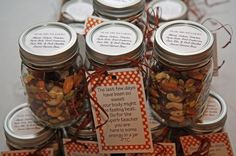Fall Teacher Appreciation Gift.  Energy in a jar meant to serve as a break from all the sweets of Halloween.  Recipe: 9C Almonds, 8C Cashews, 8C Pistachios, 6C of Pepita Seeds(inside of pumpkin seed), 6C Dried Cranberries, 6C Dark Chocolate Covered Espresso Beans.  This filled 33 Pint Mason Jars.  The label on the top lists ingredients. by deana