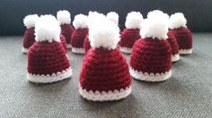 A crochet pattern for small christmas hats. With a chain attached they can be a hanging ornament. They can also be used as egg cosies or just as a cute decoration.