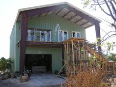 Metal Buildings as Homes | steel home under construction front