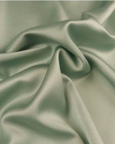 A beautifully high quality satin fabric with a 'liquid' drape and luxurious soft sheen. In a soft duck egg green shade, this stunning fabric is perfect for creating elegant silhouettes. Occasion Wear, Satin Fabric, Shades Of Green, Sea Glass, Swatch, Sewing Patterns, Colours, Truro Fabrics, Style Inspiration