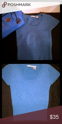 Energie Short Sleeve Sweater Like New This is a gorgeous color blue the sweater is a size small it has a cashmere feel that I love against my skin it also goes great with a blue Michael Kors purse that you will also find here in my closet the sweater has only been worn one time and is in like new perfect condition I am asking $35 for the sweater Energie Tops Crop Tops