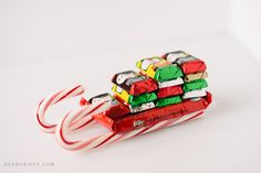 Candy Cane Sleigh Gift Card Holder - This fun candy cane sleigh is so easy to make. Cute on its own or used as a unique gift card holder!