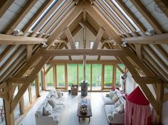 View from gallery into oak roof of barn room below