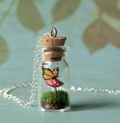 Oh my goodness, this little necklace is PERFECT for someone's birthday coming up soon!!  This is basically VICTORIA in a bottle!  lol...