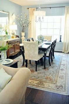 Soft, pretty dining room. Love the blue walls and the cream furniture. I need this rug!!!!!!