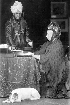 Queen Victoria with her Indian servant Abdul Karim whom she called Munshi (teacher) and who taught her Hindi. Description from pinterest.com. I searched for this on bing.com/images