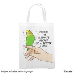"Budgies make life better grocery bag. Cute green budgerigar drawing with text: ""Here's the ultimate secret to a better life!!"" Perfect gift for parakeet parrents, budgie moms, budgie dads, budgie owners, budgie lovers and everyone else that love parakeets. #funnyparrottext #funnybudgiedrawing #budgieparakeet #budgieparrot #ilovebudgieparrots #crazyparakeetlady #parrotperson #crazybirdlady #birdquote #parrotjoke #funnyparakeethumor #parakeetsarefunny #funnygreenparakeet"