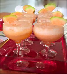Melon, lime and vodka slush drink, topped with champagne.