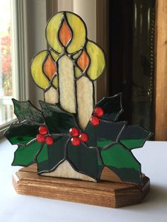 "This beautiful piece measures approximately 7"" X 9"" and comes attached to an oak base. The triple candles are attached to the holly and berries to give a 3D effect. This piece has been created using t"
