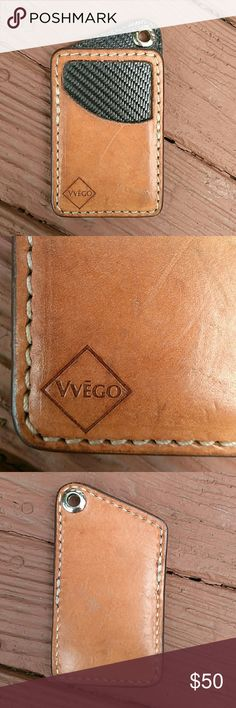 Vvego Natural Leather Front Pocket Card Wallet From Vvega International, the Combo Vvault Front Pocket Wallet- an ultra heavy duty pocket wallet with attitude. Hand- built in the USA from high-quality leather and heavy duty saddle thread. Black carbon fiber interior, can be attached to chain or lanyard. Holds 5-6 cards in 2 slots. The leather shows some minor scuffing from normal wear. Vvego Bags Wallets