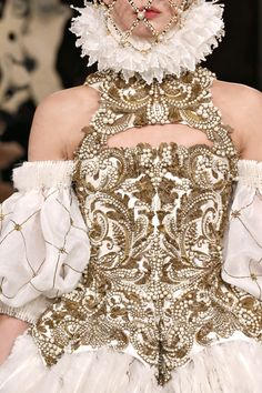 Alexander Mcqueen AW13/4 the historian in me loves the Tudor inspired work on the sleeves and ruffle.... Brocade work gorgeous too.
