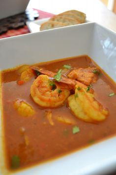 Shrimp, Scallops, and Tilapia in a Coconut Curry Broth - replace tilapia with halibut or cod or other white fish