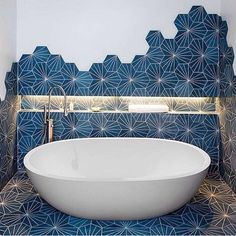 Home Love the tile creeping up the wall! Maybe for the kids bath someday, but I had to toss it in Geometric Tiles, Hexagon Tiles, Hex Tile, Tiling, Wall Tile, Downstairs Toilet, Beautiful Bathrooms, Bathroom Interior Design, Tile Patterns