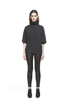 Mock Turtleneck Tunic - Tunics - Shop - Keeping things interesting with this lightweight ¾ sleeve tunic with loose fit and mock turtleneck will prove a clever fashion move. This is the right garment to pick when you want to look and feel relaxed. Wear yours with leather pants or a pair of laidback denims.