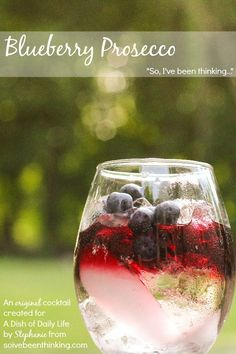 Blueberry Prosecco cocktail...blueberry vodka layered over your favorite prosecco, and garnished with fresh blueberries, raspberries, strawberries and cherries for a fun fruity drink recipe.