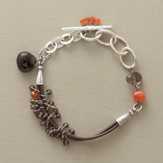 """HALF AND HALF BRACELET--Half leather, half sterling silver, our opposites-attract bracelet hosts a mélange of smoky quartz and brilliant orange carnelian. Handcrafted exclusive with hammered links and toggle. Approx. 7-1/4""""L."""