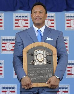 Roberto Alomar poses with his plaques