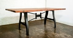 A-leg dining table; reclaimed joined timber from local markets, hand-cast solid iron table legs formed from salvaged vintage stamp machine.