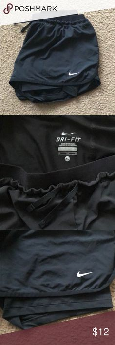 Nike Dri-Fit Running Shorts Black Nike running shorts - 2 inch inseam. Compression shorts built in underneath. Like new, only worn handful of times Nike Shorts