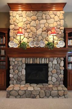 River rock fireplace i kind of like the big rocks for the dining fireplace river rock built ins google search solutioingenieria Image collections