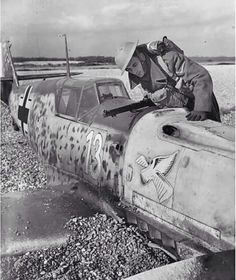 A member of Britain's Home Guard inspects an Me109 fighter shot down during the Battle of Britain, 1940