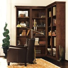 or you could do a corner unit like this in the corner closer to the front door… and use the back wall for a beautiful sofa and lamps 5 Piece Corner Bookcase Set - Corner Wood Bookcase Set