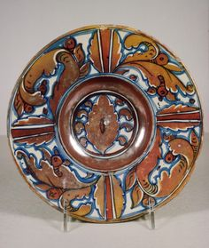 Dish with Foliage Design, Gubbio, Italy, ca. 1525-1530, earthenware with tin glaze (maiolica) and luster decoration, 4.7 x 21.7 cm, The Walters Art Museum, 48.1367