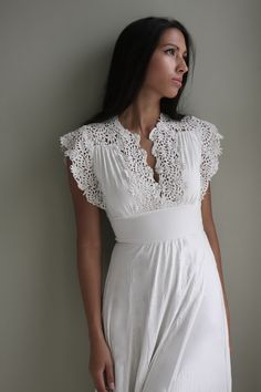 A vintage lace dress conjures up images of royal families and courtesies that now belong to the past.