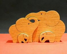 Check out this item in my Etsy shop https://www.etsy.com/uk/listing/495049139/elephant-family-family-of-4-wooden