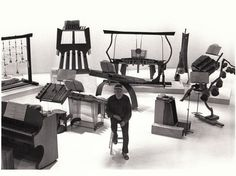 Harry Partch with a grouping of beautiful and unique instruments that he designed.
