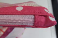 Sewing a Zipper in a Bag from Patchouli Moon Studio- love the tabs at the end of the zipper