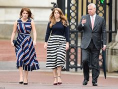 Walk to remember: Princess Eugenie (left), Princess Beatrice (centre) and their father Prince Andrew (right), made their way out of the palace on foot to greet the crowds