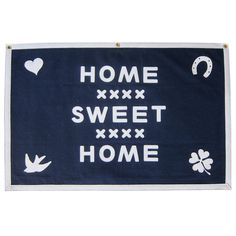 Lovely folk art cross-stitch-inspired heavy wool felt wallhanging banner. Features fully-stitched lettering, icons and border and three brass grommets for...