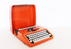 We'd trade in our computers for this #retro #orange typewriter. Well, maybe not, but we still love it!