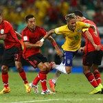 Neymar of Brazil is challenged by Jose Juan Vazquez of Mexico, Rafael Marquez and Marco Fabian