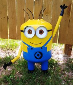 So much better than a garden gnome!!  Minion made from a disposable helium tank, copper pipe arms, and galvanized pipe legs.  Painted with enamels and acrylics.