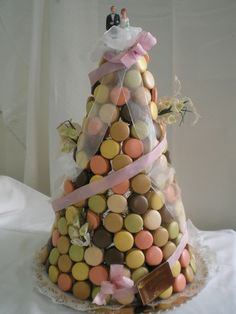 A Macaron pyramid gives a nod to the traditional French wedding cake, the croquembouche.