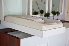 Install a fold down changing table. | 25 Hacks To Make Room For A Baby In Your Tiny Home