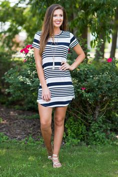 """So Relaxing T-Shirt Dress, Navy""Talk about trendy! This adorable casual t-shirt dress features classic colors in trendy stripes for a look we can't help but love!  #newarrival #shopthemint"